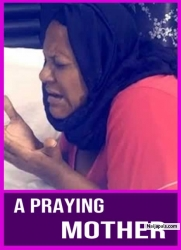 A PRAYING MOTHER